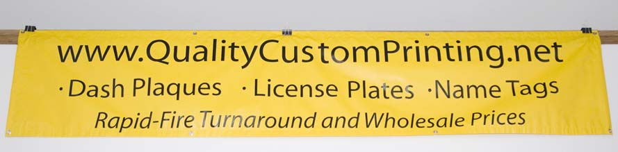 10 foot by 2 foot yellow banner with black lettering